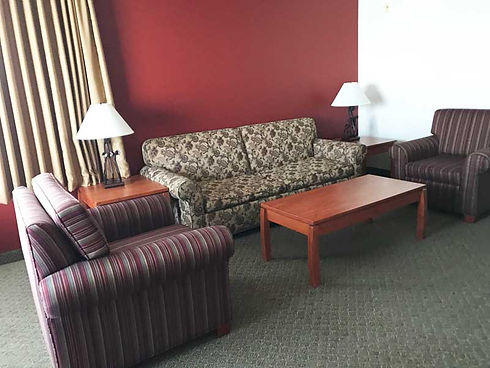 Couch with two chairs in suite guestroom