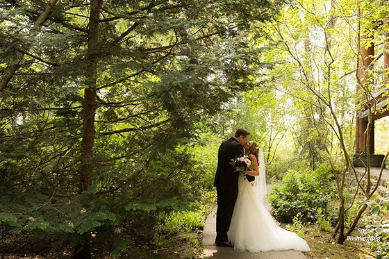 Wedding Couple kissing in the trees behind the heathman lodge