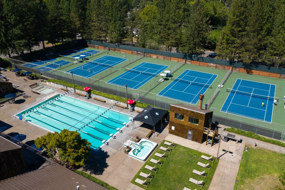 Outdoor tennis courts and swimming pool at West Hills