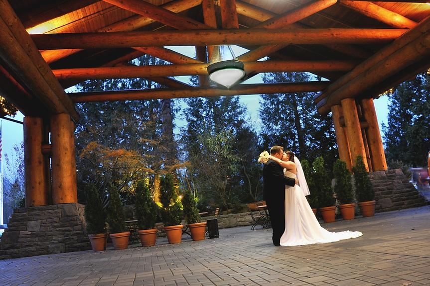 Bride & Groom under the portico kissing