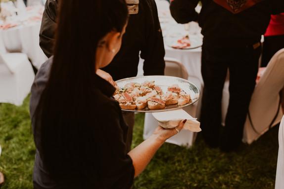 server serving appetizers at wedding rec