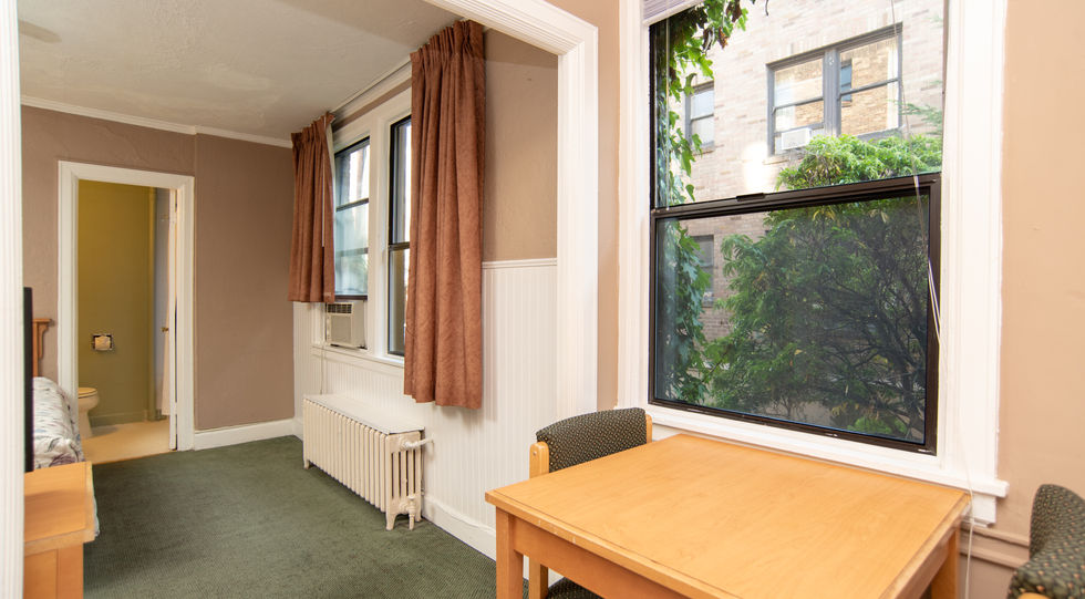 guestroom with table and chairs