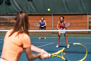 Women playing tennis at West Hills