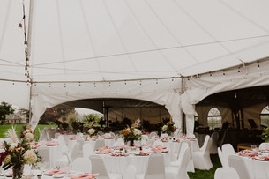 wedding reception set up under tents