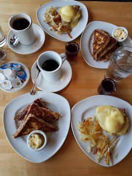 Table full of breakfast items