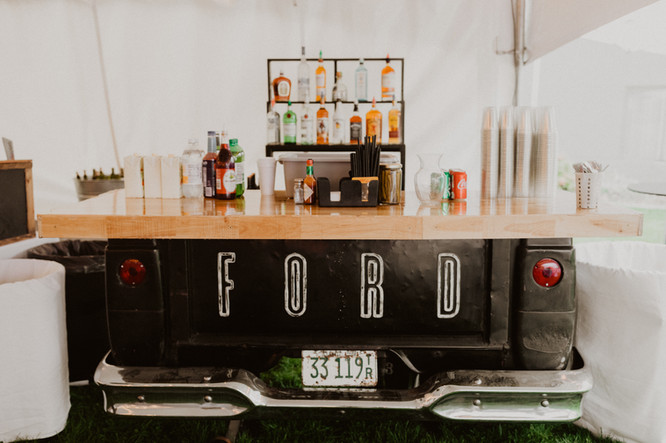 Tailgate of Ford truck converted into a bar for w