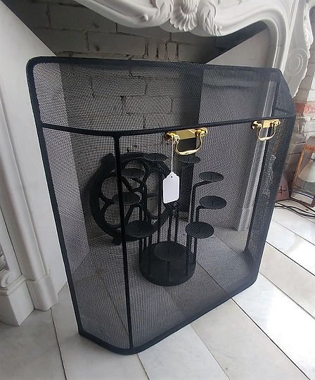 Curved mesh stock fireplace screen black mesh with polished brass handles at The Fireplace Shop Ltd.