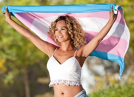 Young trans woman raising transgender flag
