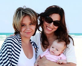 Lesbian couple holding baby