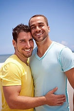 Gay couple arms around each other
