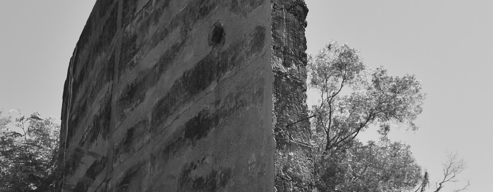 Remnant wall of WWII oil storage tank, Stokes Hill.