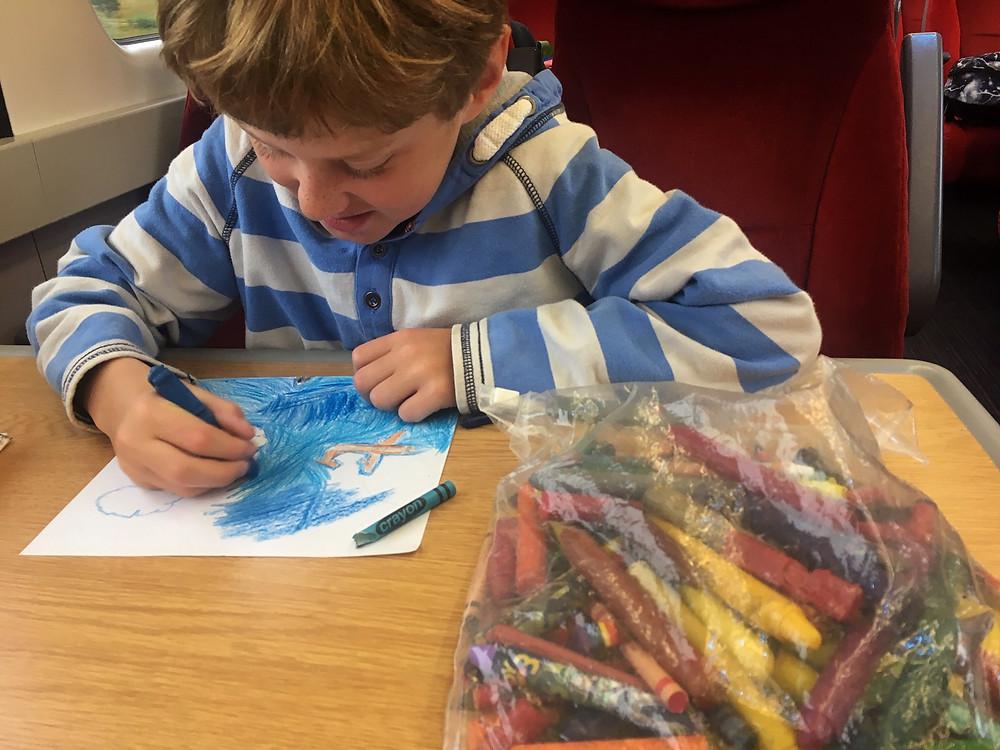 A child drawing an aeroplane