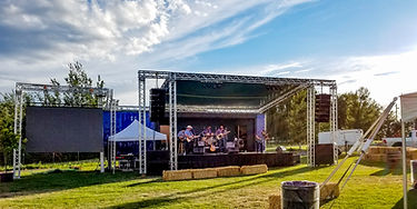 Outdoor concert with staging, audio, and lighting