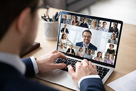 Person attends virtual conference on laptop computer