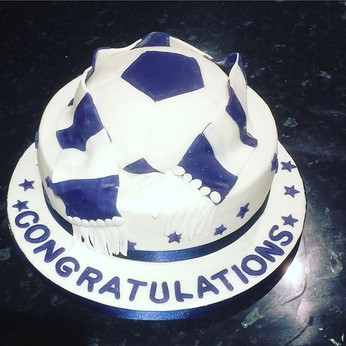 Football themed cake for one of my daugh