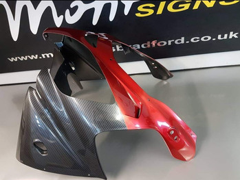 bike parts dipped in carbon with candy red