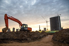 Red excavator during groundwork on const