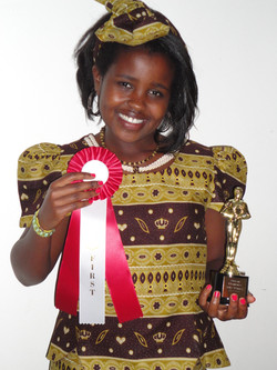 Picture of Winner of African E. Oct 19, 2013 + Trophy.jpg