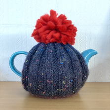 Lovely knitted tea cosies by Ella Wiggans.