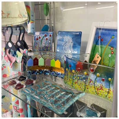 Beautiful glass display by Glazed Over Glass Designs