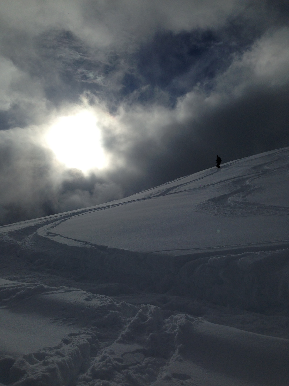 A brief break in the clouds after a blizzardy and windy day, allowed for an afternoon of fresh powder and empty slopes