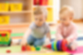 Preschool boy and girl playing on floor