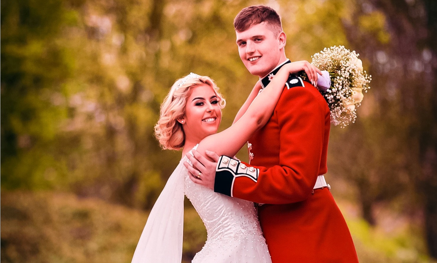 Bridge & groom pose for photographs