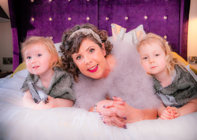 Bride on bed with flower girls