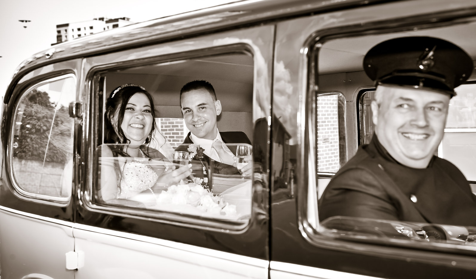 Wedding Photography of bride & groom chaufeur driven