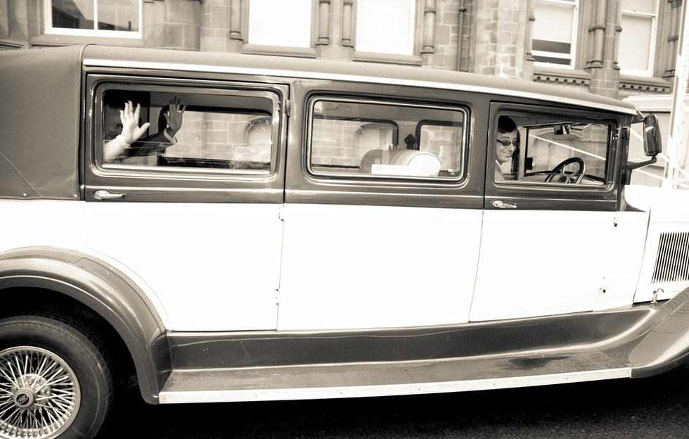 Documentary Wedding Photography as couple wave
