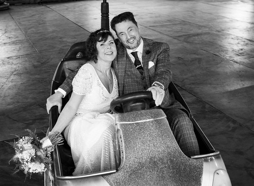 Wedding couple just had to get in a Dodgem.