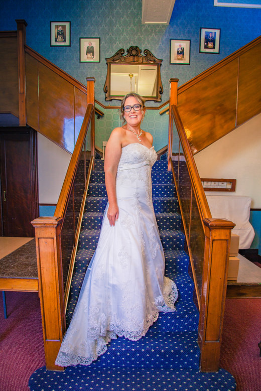 Bride on stairs Masonic Hall