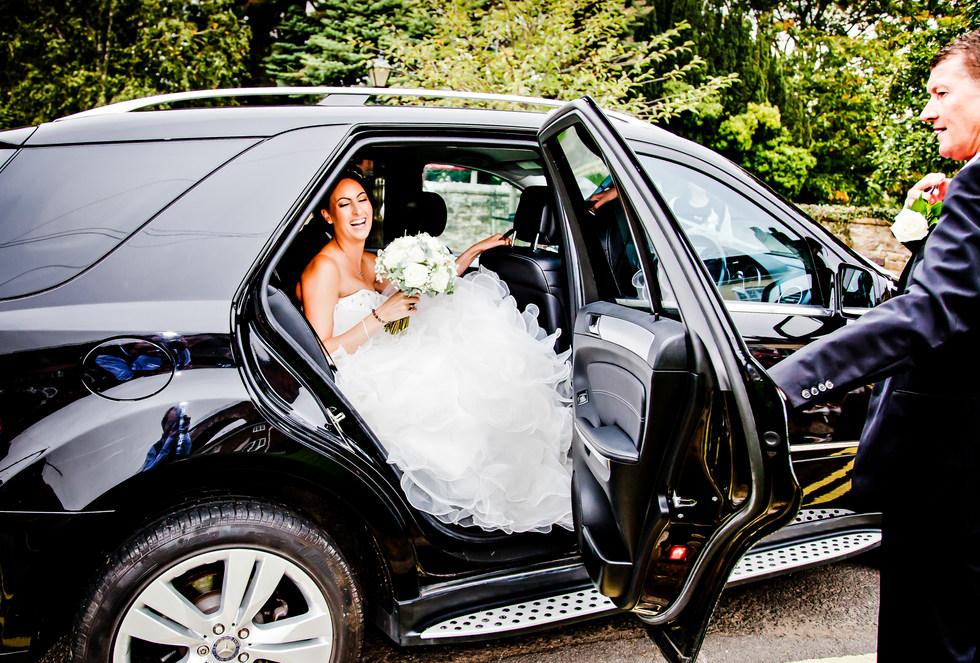Wedding bride arriving at wedding ceremony
