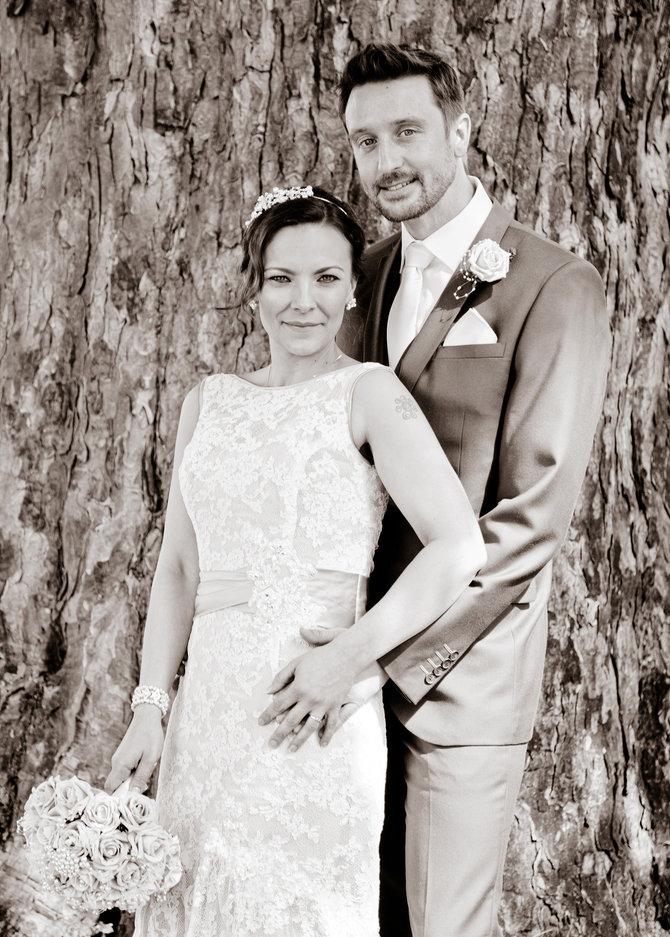 Wedding Couple pose by tree