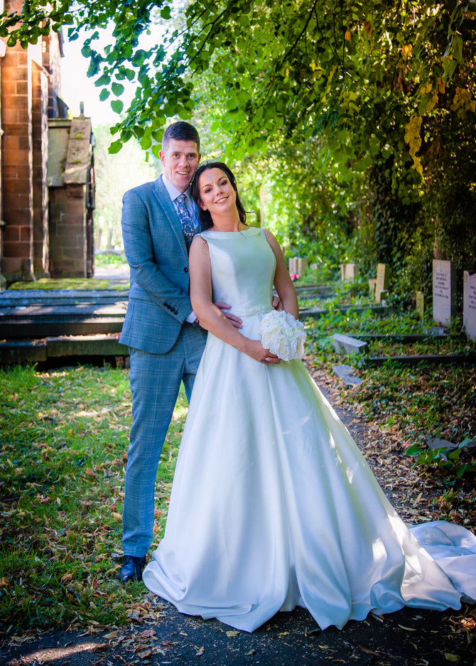 Bride & groom pose at St. Cuthberts church
