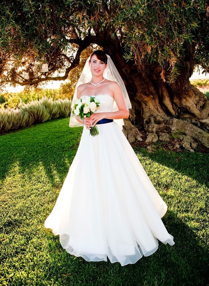 Bride Poses under Olive Tree