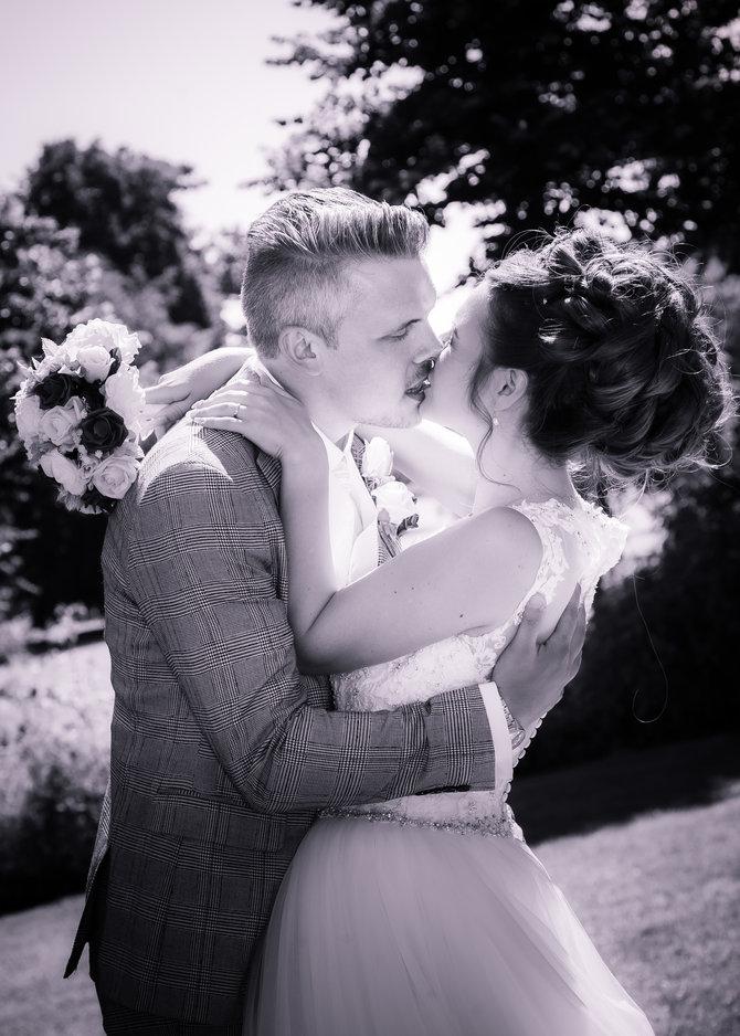 Wedding groom kisses the bride