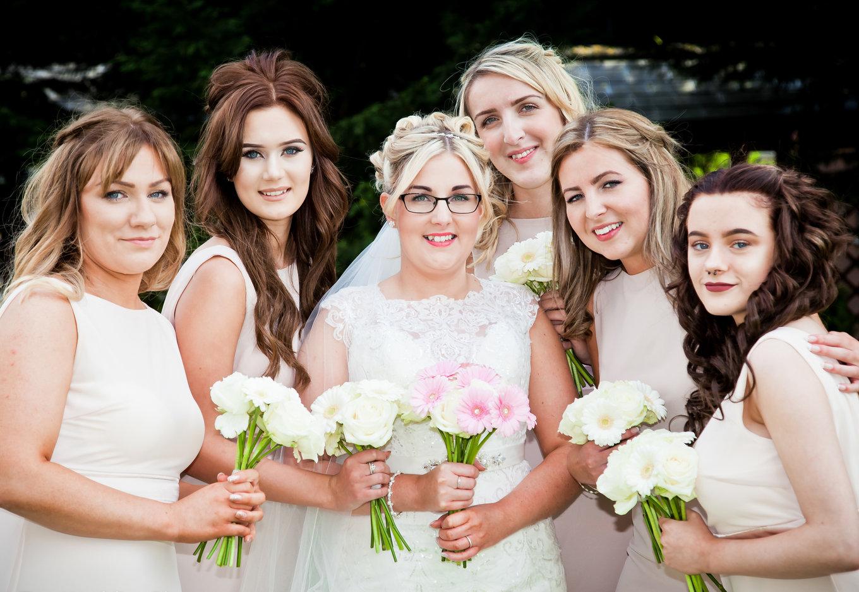 Bride Bridesmaids pose