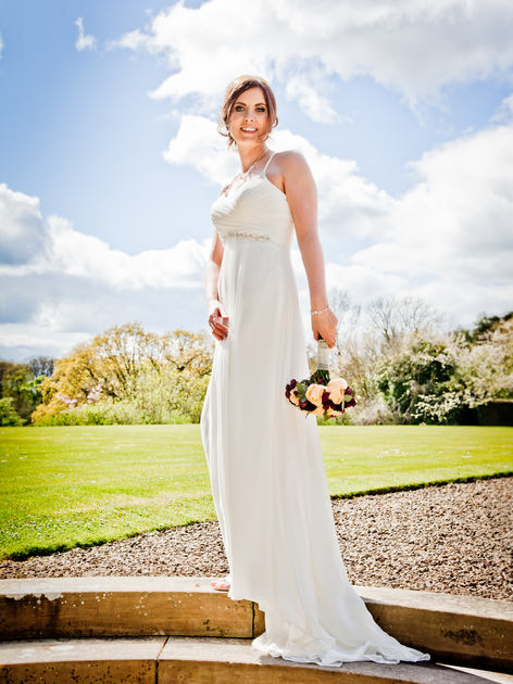 Wedding bride poses at Crathorne Hall