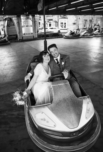 Bride & Groom on fairground ride