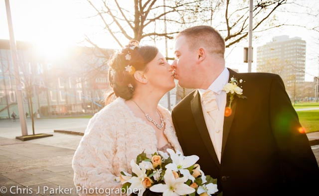Wedding bride & groom kiss