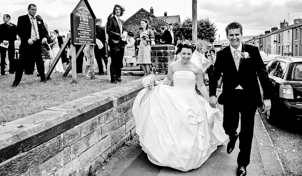Reportage photography of Bride & Groom leaving the church