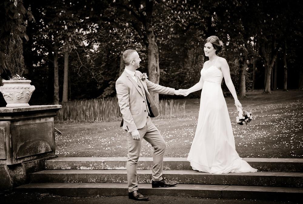 Bride & Groom Hold hands on steps