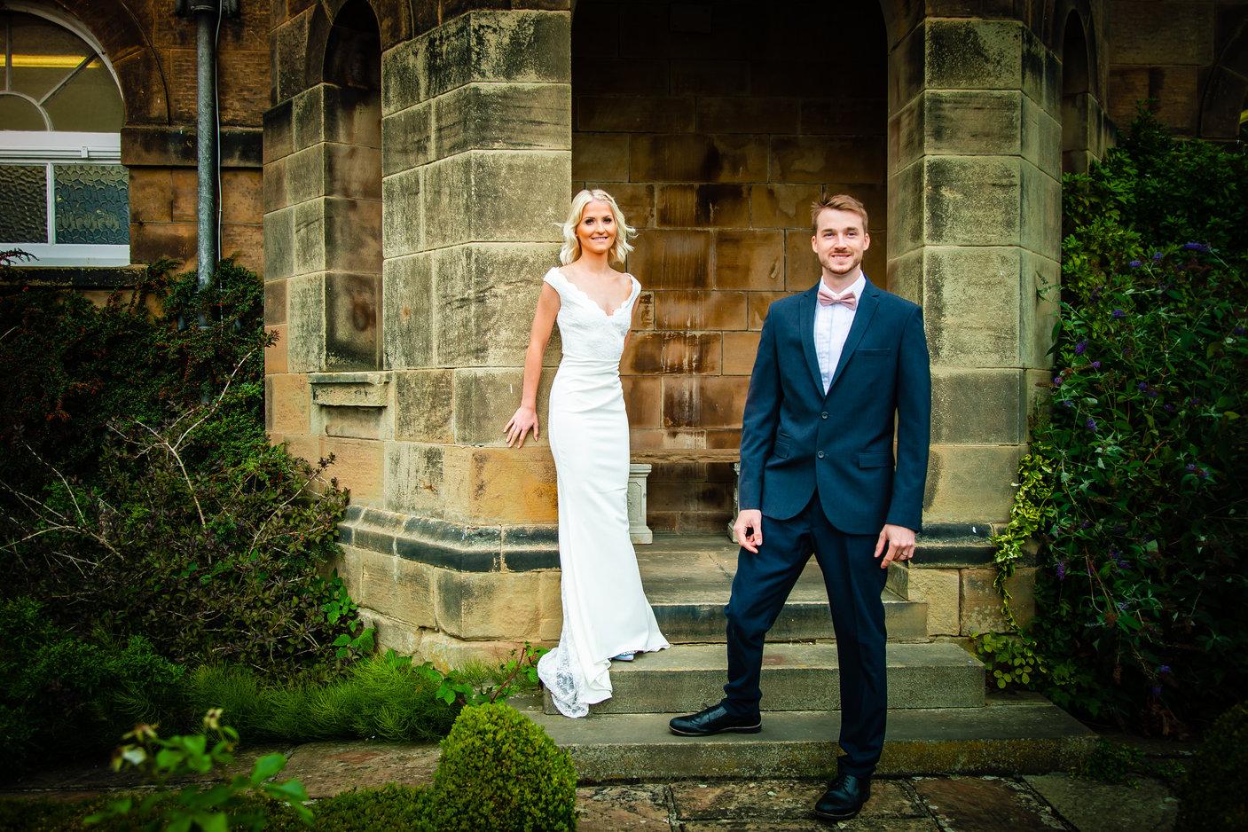 Wedding couple pose for photos