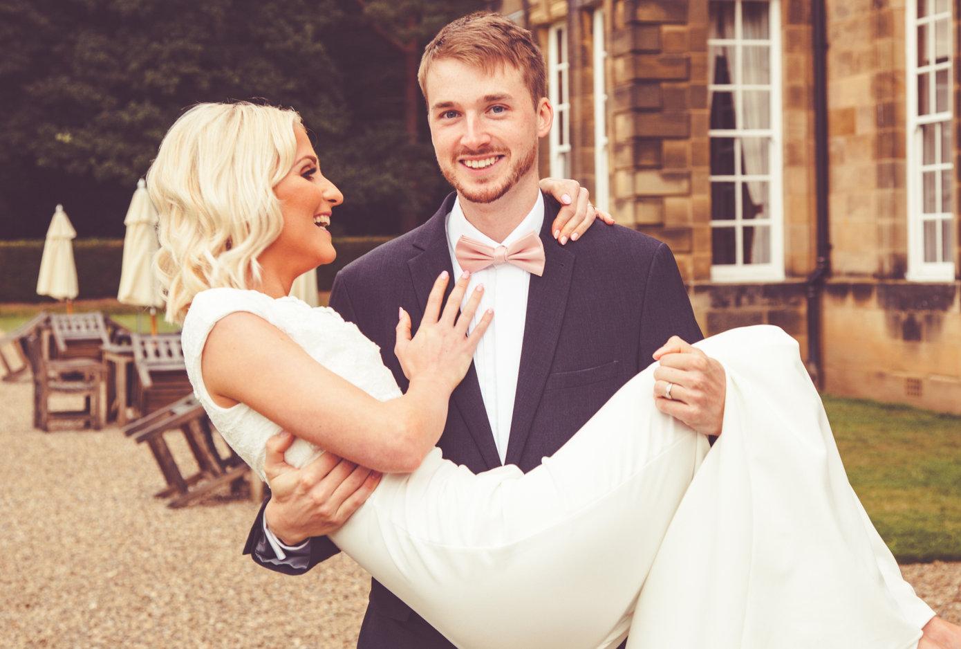 The Wedding groom carries his bride at Crathorne
