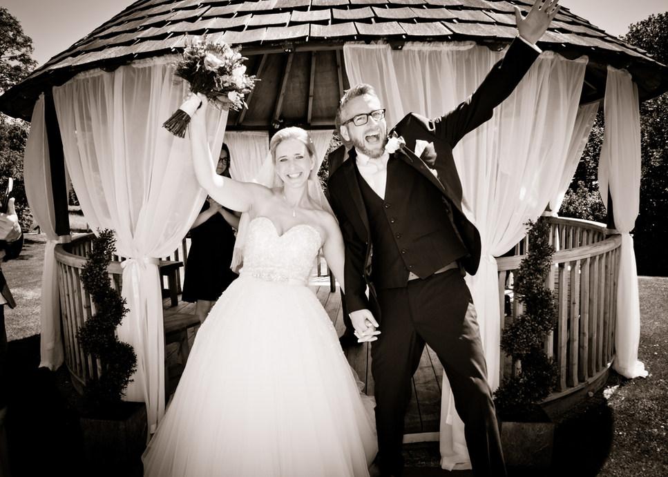 Wedding couple photographed Celebrating
