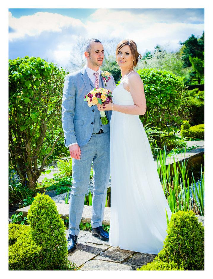 Wedding couple pose for wedding photographs
