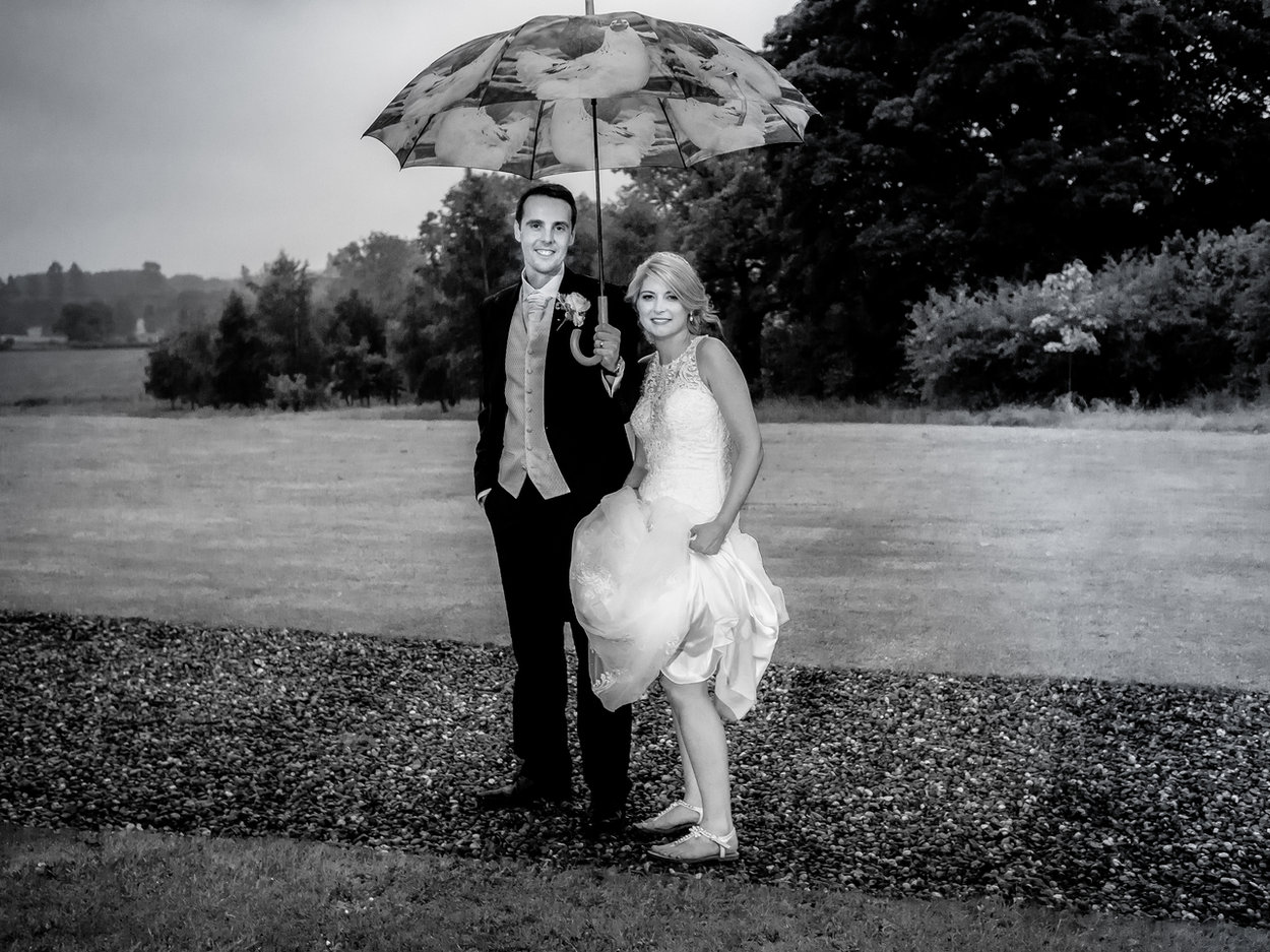 Bride & groom with umbrella