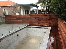 Pool deck balustrading screening concrete tiling piles