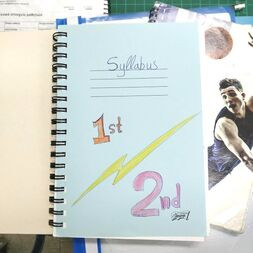 a picture of a notebook with a syllabus for 1st and 2nd grade english